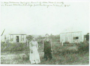Mr. and Mrs. Hermann Seeliger in front of their newly completed home in Uhland in 1895. Their cumbersome clothing was the typical mode of dress during this era, and while the home was new, there were not even suggestions of conveniences the modern housewife and her family enjoy.
